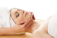 Portrait of a young woman laying on a massage Royalty Free Stock Photos