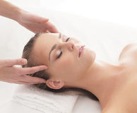 Portrait of a young woman laying on a massage Stock Photo
