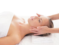 Portrait of a young woman laying on a massage Stock Image