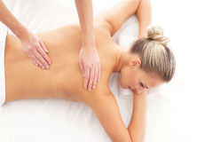 Portrait of a young woman laying on a massage Stock Images
