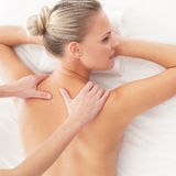 Portrait of a young woman laying on a massage Royalty Free Stock Photo