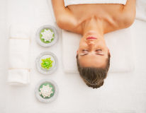 Portrait of young woman laying on massage table Royalty Free Stock Images