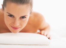Portrait of young woman laying on massage table Stock Photos