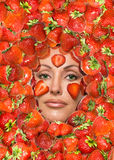 Portrait of young woman, laying under strawberry Royalty Free Stock Photos