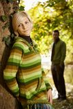 Portrait of young woman leaning to tree trunk Royalty Free Stock Photo