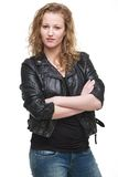 Young Woman in Leather Jacket with Arms Crossed Stock Images