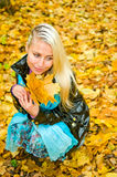 Portrait of young woman with leaves Stock Image