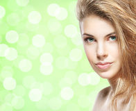 Portrait of a young woman on a light green background Stock Photo