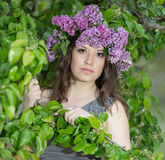 Portrait of young woman in lilac wreath Stock Photos