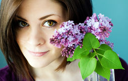 Portrait of young woman with lilacs Stock Photo