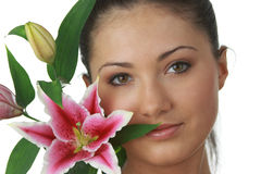 Portrait of young woman with lilly. Portrait of young attractive woman with beautiful lilly flower Stock Images