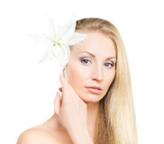 Portrait of a young woman with a lily flower on white Royalty Free Stock Images
