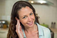 Portrait of young woman listening to music Stock Images