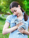 Portrait of a young woman with a little bunny Stock Photos