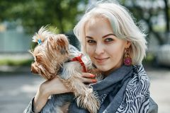 A Portrait of a young woman with a little dog. Portrait of a young woman with a little dog royalty free stock photography