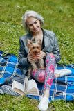 A Portrait of a young woman with a little dog. Portrait of a young woman with a little dog royalty free stock images