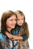 Portrait of young woman and little girl. Stock Image