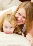 Portrait of young woman and little girl Royalty Free Stock Images