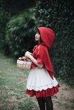 Portrait young woman with Little Red Riding Hood costume royalty free stock image