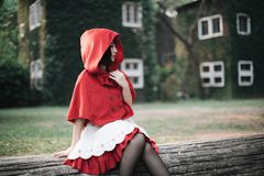 Portrait young woman with Little Red Riding Hood costume stock photography