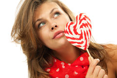Portrait of young woman with lollipop Stock Photos