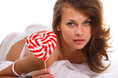 Portrait of young woman with lollipop Stock Photo