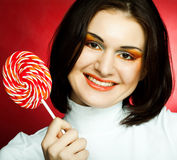 Portrait of young woman with lollipop Royalty Free Stock Image