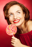 Portrait of young woman with lollipop Royalty Free Stock Photography