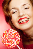 Portrait of young woman with lollipop Royalty Free Stock Images