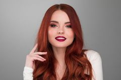 Woman with long ginger hair. Portrait of young woman with long beautiful ginger hair royalty free stock photography