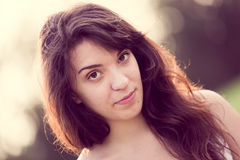 Portrait of young woman with long dark hair Stock Photo