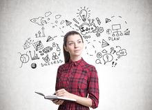 Young woman with a planner, business plan Stock Photo