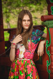 Portrait of young woman with long hair at alcove Royalty Free Stock Image