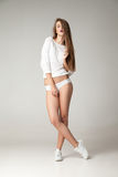 Portrait of young woman with long hair in undies Royalty Free Stock Photo
