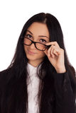 Portrait of young woman looking over glasses. Portrait of young business woman looking over glasses Stock Photography