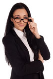 Portrait of young woman looking over glasses. Portrait of young business woman looking over glasses Stock Image