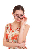 Portrait of young woman looking over glasses. Portrait of young attractive woman looking over glasses. Shot over white background Stock Photography