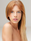 Portrait young woman looking over naked shoulder Royalty Free Stock Photos