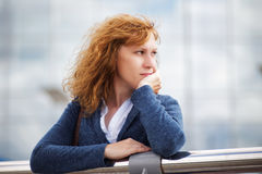Portrait of a young woman looking thoughtfully into the distance Stock Photos