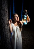 Portrait of young woman lost in forest at night Stock Photos