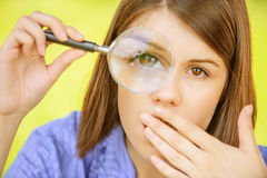 Portrait of young woman with loupe Royalty Free Stock Image