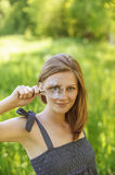 Portrait of young woman with loupe Stock Image