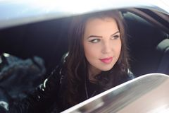 Portrait of young woman in love in a car stock photography