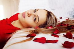 Portrait of Young Woman Lying on Bed Royalty Free Stock Images