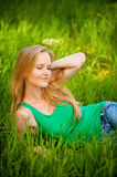 Portrait young woman lying green Stock Image