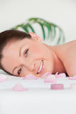 Portrait of a young woman lying on a massage table Stock Image