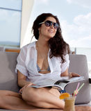 Portrait of a young woman with a magazine on her lap Royalty Free Stock Photography