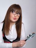Portrait of young woman with a magnifier Stock Photo