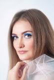 Portrait of a young woman with make-up in blue colors Stock Images
