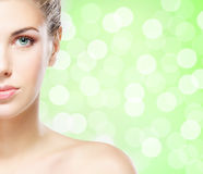 Portrait of a young woman in makeup on green Stock Photos